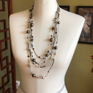 multi strand med length necklace silver & bronze.